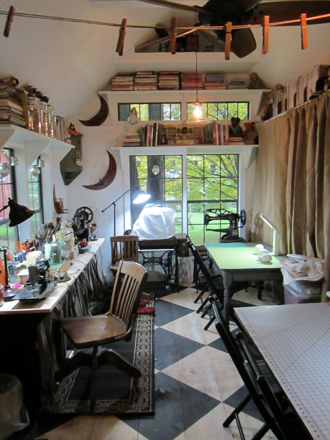 The interior of my first studio. Admittedly it is not usually this tidy, as there are piles of antique quilts and drifts of frothy white petticoats on most of the surfaces... all waiting to have their best bits , cleaned, restored, salvaged and turned into tiny clothing for the dolls.