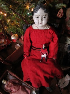 "This large papier-mache boy was a present from my husband several Christmases ago.  He is wearing a ""new"" dress for Christmas that I just bought for him from Edyth O'Neill. It arrived today and I couldn't wait to try it on him."