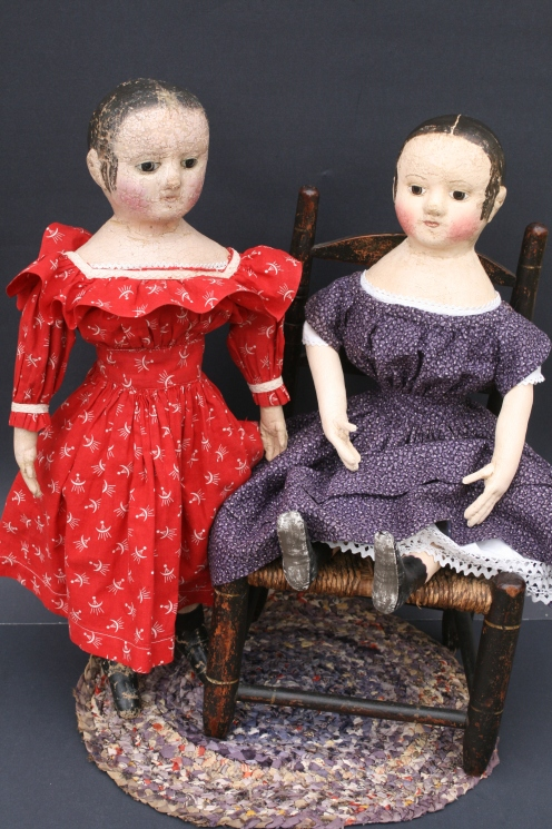 "My c. 1860 antique Izannah Walker doll in red on the left and her newly made offspring c. 2013 dressed in dress made of rare ""double violet"" mid-19th century fabric."