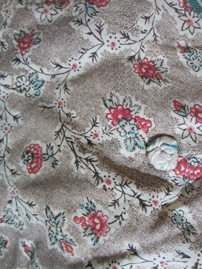 I was thrilled to find part of a very early tied quilt.  This practically pristine 18th century chintz is going into my Queen Anne doll making supply stash.