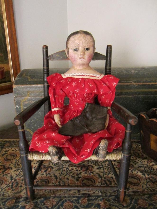 My antique Izannah Walker holding an antique child's lace up boot.