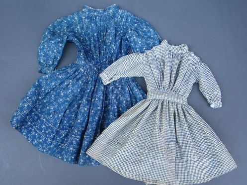 Evelyne sent me a photograph of an antique Izannah Walker wearing a dress that was made in a very similar way to the indigo print dress on the left.  I bought the antique  indigo dress last September with the intention of using to draft a pattern.  Evelyne's request for a blue check dress motivated me to finally get a pattern drawn up.
