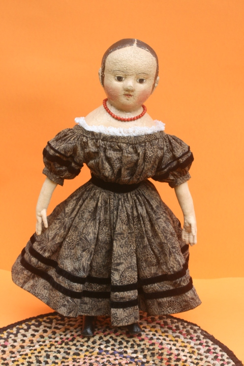 Isabeau #2 in her black party frock.  The dress fabric dates to the late 1800's.  Rows of antique black velvet ribbon encircle the sleeves, waist and hem of the dress.