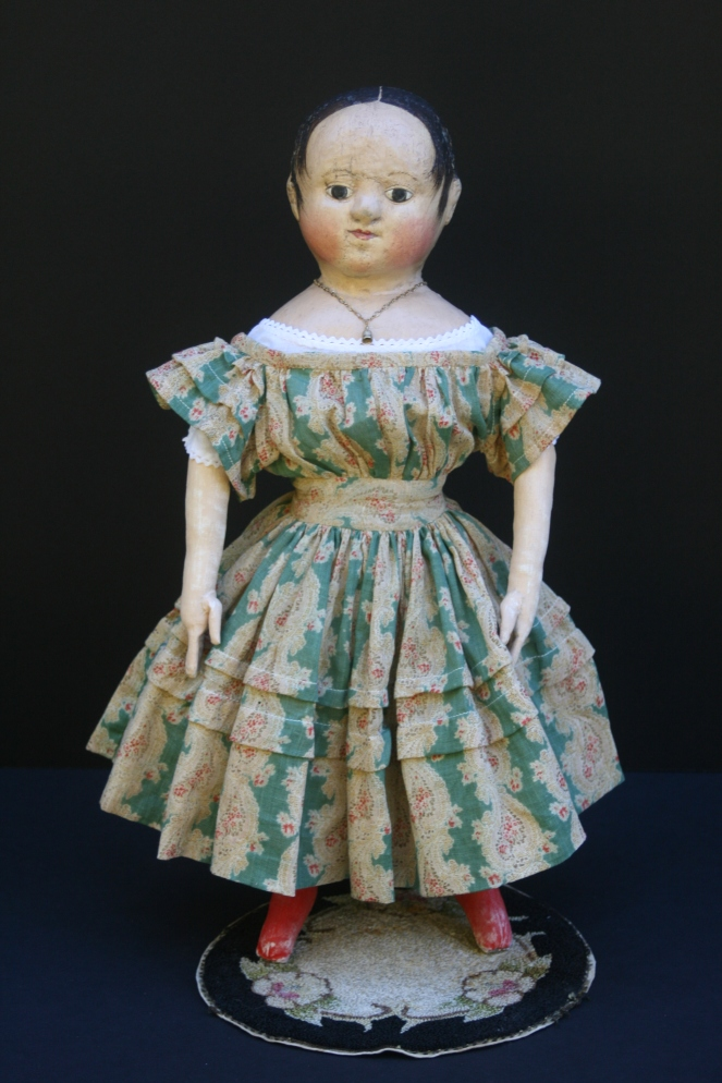 Anna #2 is shown here wearing her dress made from a very early c. 1830-1840 cotton gauze paisley print.  The green, red, brown and ivory fabric is perfect for late fall and the upcoming Christmas season.  The sleeves and skirt of the dress have graduated growth tucks.