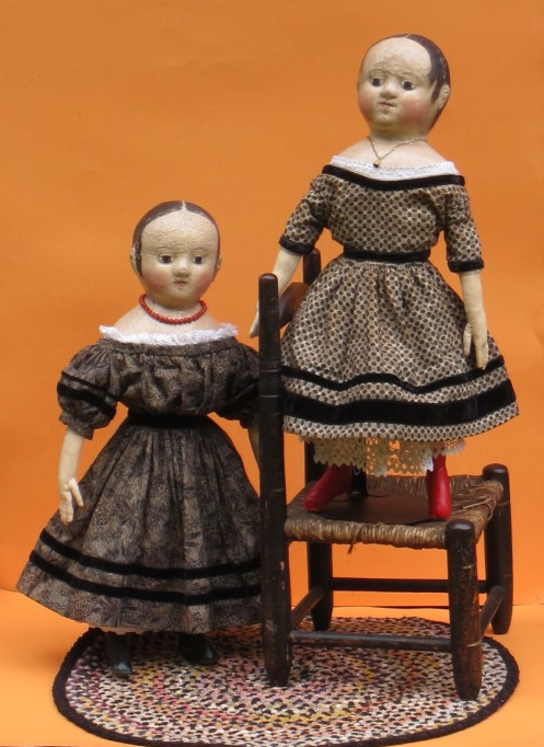 """Isabeau #2 & Anna #2 show off a little Black Magic for All Hallows Eve.  Black dresses are one of my favorites year around because they are a neutral accent in any room and the dark color will draw your eye to the doll and make her painted features """"pop"""" and glow."""