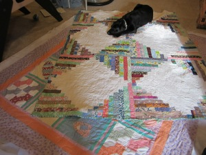 Here is what our quilts looked like at the end of the day.  Mine is all done and my sister's just needs to be bound!