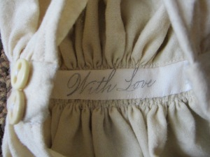 A surprise sentiment hides inside the waist band of her dress.