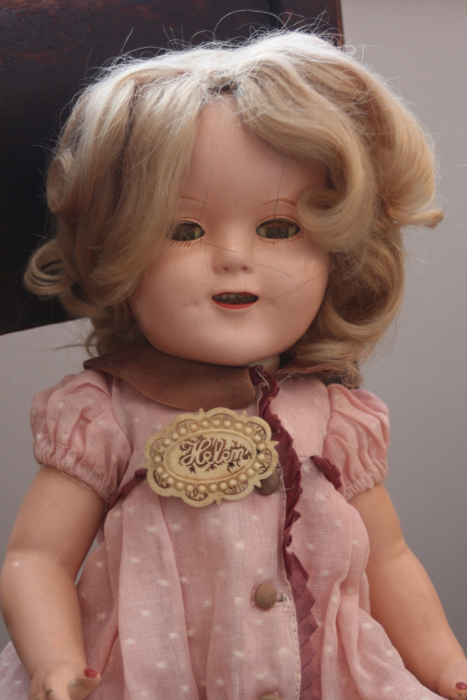 My mother's Shirley Temple doll is wearing a celluloid pin I bought because it reminds me of my mom.