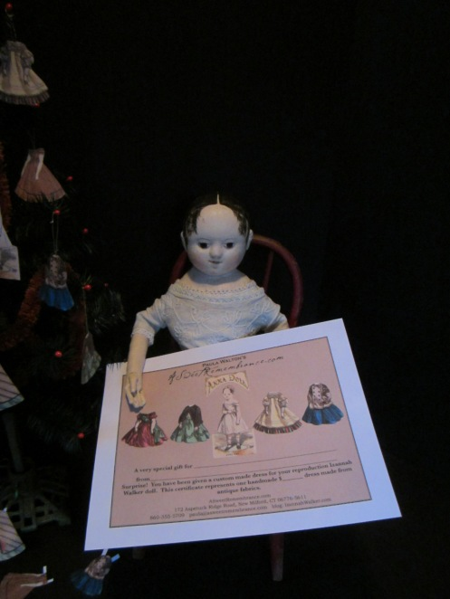 My gift certificates feature images of antique paper dolls that have been altered.  Illustrations of my Izannah Walker reproduction dolls now replace the original paper doll heads.