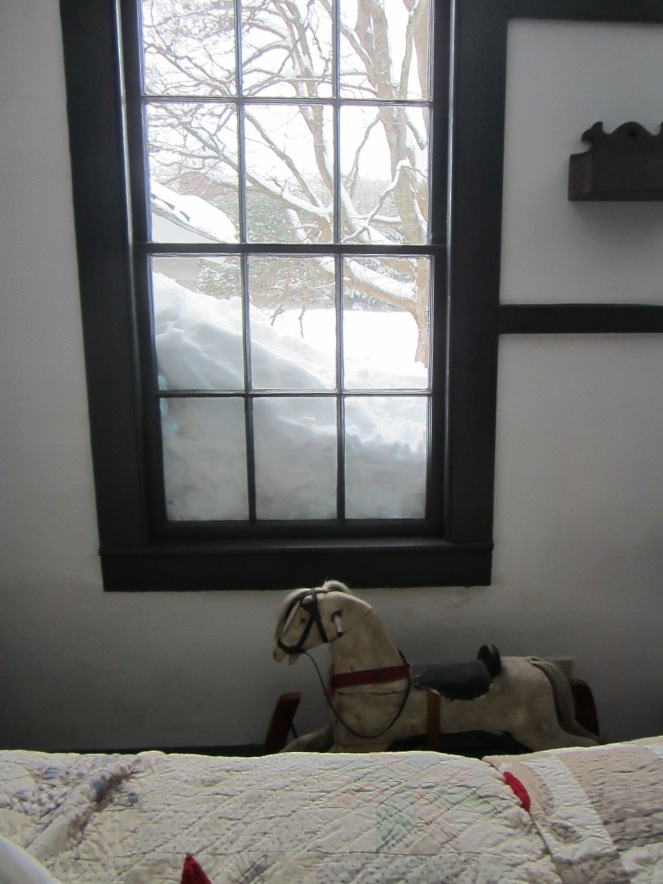 The foot of new fallen snow, on top of the snow from the last storm, obscures some of our second floor windows.