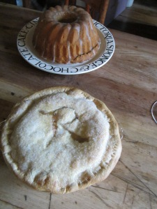 Freshly baked rhubarb pie, with the first of this year's rhubarb from my garden, & vanilla violet pound cake.