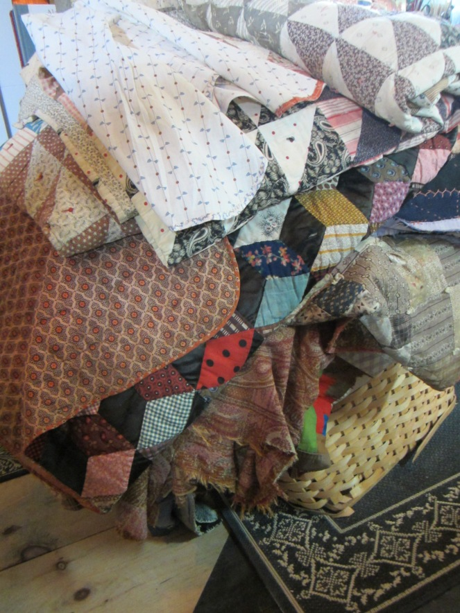 I'm feeling a bit like the princess and the pea with this new waist high stack of antique quilts in my studio!