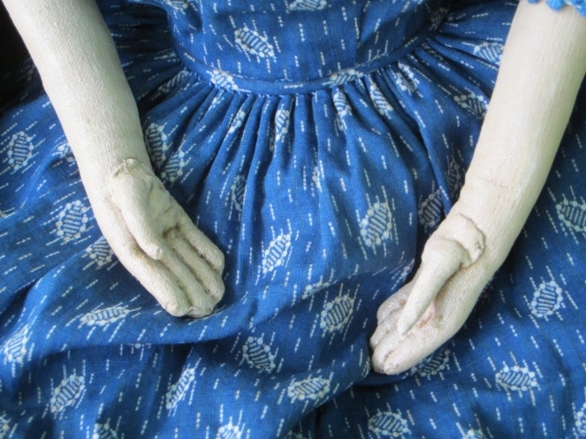 I cartridge pleated the skirt of this dress.  Mary requested thumbs that are folded close to the palms of the hands.