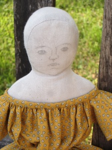 Even though this doll isn't as fancy, her simple pencil sketch features tug at my heartstrings...