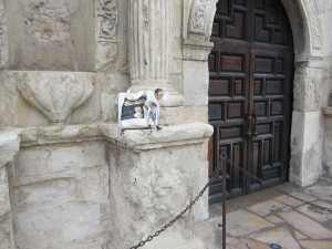 Izzybelle posing by the doors of the church at the Alamo.