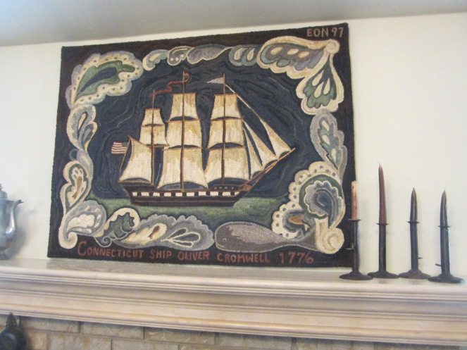 This outstanding rug hangs over the mantle in Edyth's living room.
