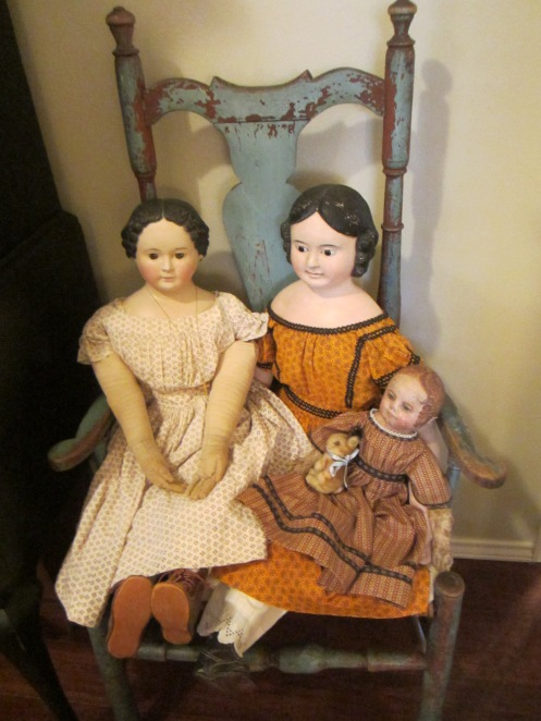 Two papier-mache dolls and a Martha Chase doll that Edyth has repainted.