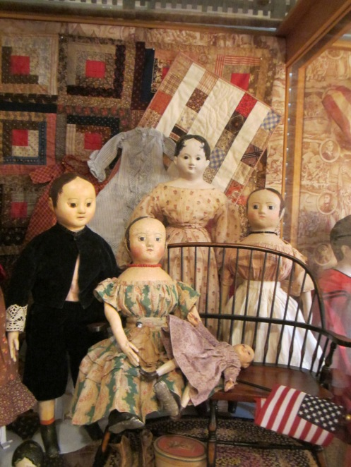 It was really nice to be able to see two of the dolls I've made again (the one in the green and red dress sitting on the bench and the one in the apron standing behind the bench).  On the left hand side of the picture is a boy doll made by Jan Conwell and the tallest doll in the back is one of Edyth's antique papier-mache dolls.