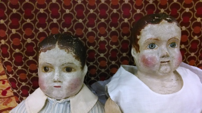 A close up of the very sweet faces of two later Izannah Walker dolls.