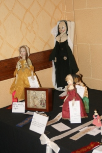 Wonderful early wooden dolls at the UFDC 2014 convention competitive exhibit.