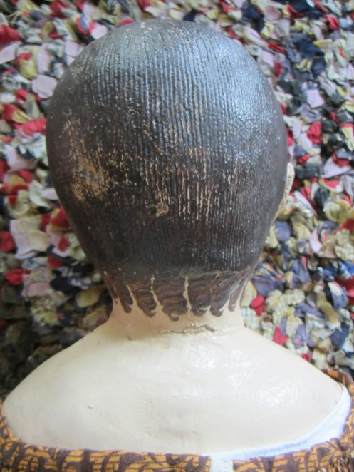 This doll has a very interesting seam line at the bottom of the hairline.  The stockinette at the back of the head is a wider rib than that on the front of the head and back of the neck.
