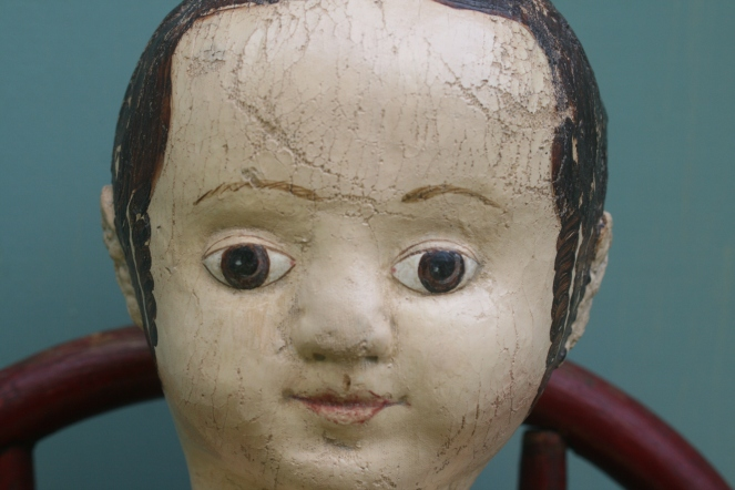 If you look closely you will see that the lines around the eyes of this doll are thinner than those of later dolls and brown rather than black.