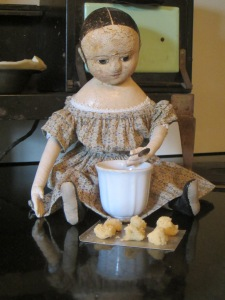 The older dolls decided that Izzybelle couldn't get into too much trouble if they let her sprinkle the sugar on top of the cookies...  After all it couldn't be any messier than what Izzybelle really wanted to do, which was make rows and rows of mud pies for the party!