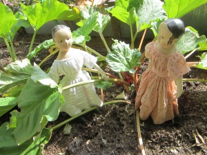 While Isabeau and Isane tackled the pie crust, little Isane and little Ismay walked out to the garden to gather some rhubarb.