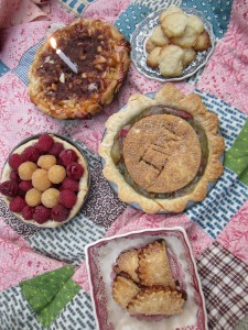 Peach jam tart with a crumble topping, sprinkled with cinnamon and sugar. Rhubarb pie. Fresh rapsberry pie drizzled with homemade raspberry syrup.  Tiny peach jam hand pies & Izzybelle's sugar cookies!