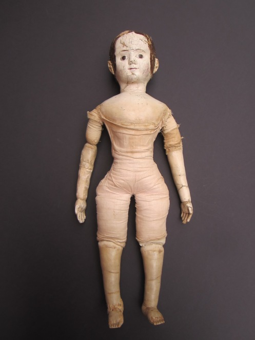 The doll's linen second skin also needed repairs and a newly made replacement arm was itself in need of replacement.