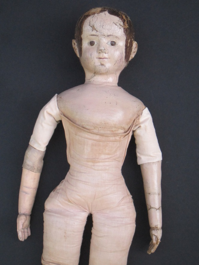 "A third after restoration photo.  The change in color is very subtle. These photos were taken before the doll was seen by her owner. After the owner had a chance to see the replaced arm and replaced antique linen upper arm covering, we decided to ""age"" the fabric and arm more."