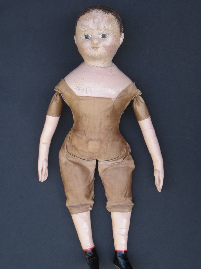 These photos were taken before the restored doll was shown to her owner.  After she got a chance to see the doll, we decided to add additional aging to the new arms.  I always like to consult with owners through out the restoration process to make sure that the cosmetic part of the restoration looks the way they want it to.