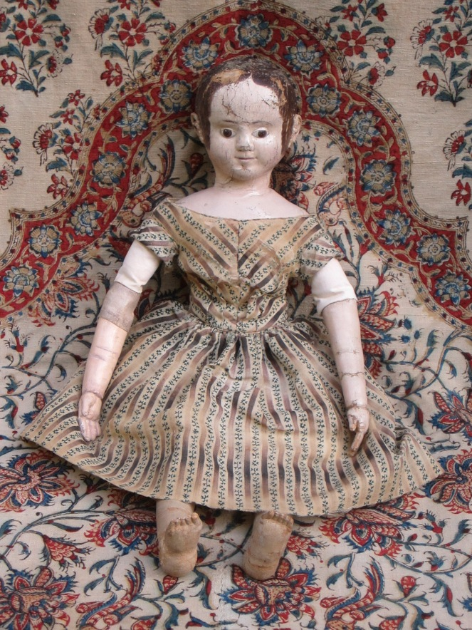 "A 2nd after restoration photo.  The change in color is very subtle. These photos were taken before the doll was seen by her owner. After the owner had a chance to see the replaced arm and replaced antique linen upper arm covering, we decided to ""age"" the fabric and arm more."