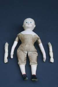 After restoration.  The old replacement arms are being preserved as part of the doll's history.