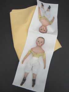 Make two dolls with each panel by adding your own plain fabric on the back.