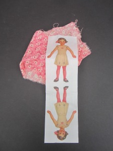 I love this antique pink fabric with this little fabric version of one of my antique Dennison paper dolls.  After sewing and stuffing her, dress her in crepe paper frills like the originals.