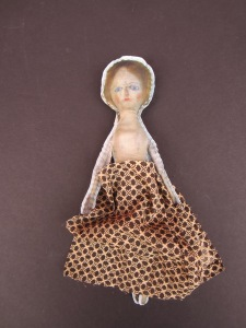 Tiny scraps of antique fabric can be fashioned into clothing for your tiny dolls.