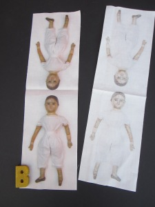 The outline of the doll is clearly visible on the back side of the fabric, which  makes stitching them together easier!