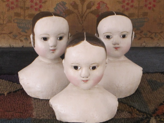 Here are three painted composition heads (all for use with my Izannah Walker Doll Making Kit).  Notice the difference between the two in the back, compared o the younger more baby like features of head #1, in the foreground.