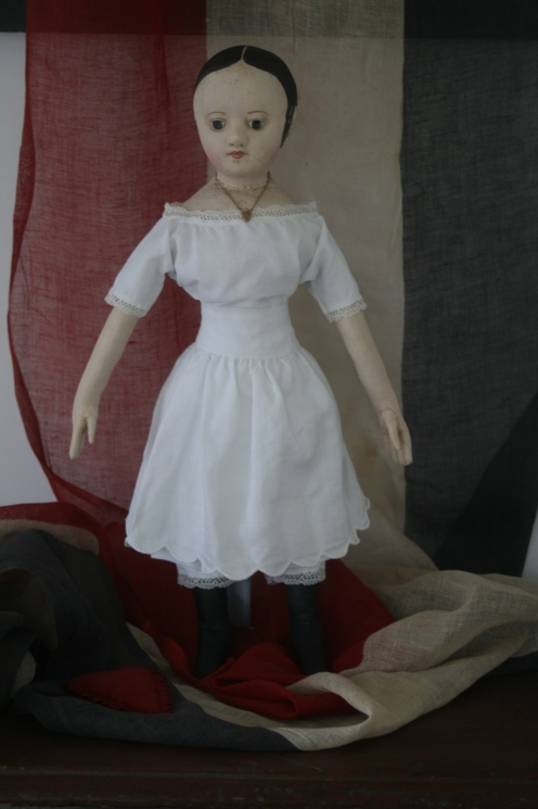 A scalloped hem petticoat is the last layer of her undergarments and echos the theme of her scallop lace trimmed chemise and pantalettes and her scallop topped boots.