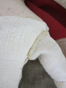 A fortunate find was this antique linen with a crochet edge, which makes the perfect finish to the top of her arm coverings.