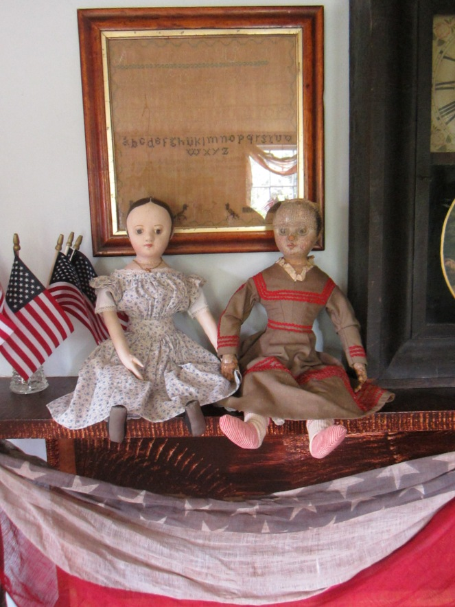 The original Ismay, on the right, is a very early example of one of Izannah Walker's dolls.  My reproduction custom ordered Ismay on the left is a faithful recreation of the original, with custom details specified by her new owner.