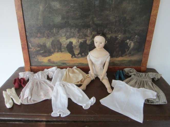Carole's doll and her wardrobe.