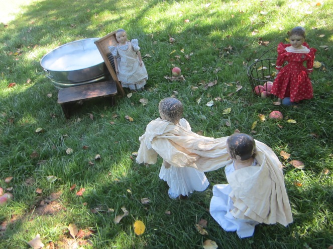 It was a hot day so the girls decided to do the wash in the shade of the apple tree.