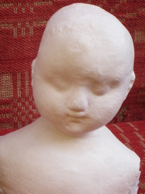 Notice all of the paint texture of the original antique doll is captured in this composition head.