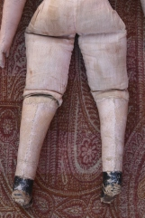 Note the seam placement down the back of the leg which is indicative of a very early Izannah Walker doll.