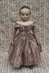This dress has a fitted bodice and sleeves, with a cartridge pleated skirt.
