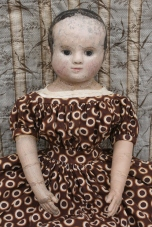 Emmaline after restoration. Wearing a reproduction dress made from antique fabric.