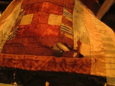 Taking apart a decayed silk quilt block to salvage the antique cotton fabric underneath.