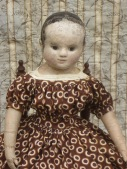 Emmaline looks very pleased with her dress made from madder printed polka-dots.